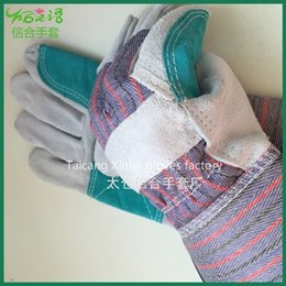 Hard-wearing and heat resisting hickened leather labor glove for protection safety working gloves factory direct sale