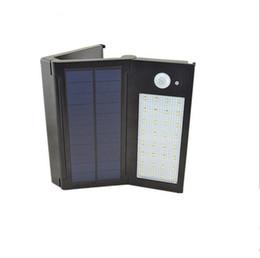 32 LED солнечных батареях свет панели сада Складные настенные лампы Прожекторы LED Солнечный уличный свет перезаряжаемые освещение лампы от Поставщики панель раз