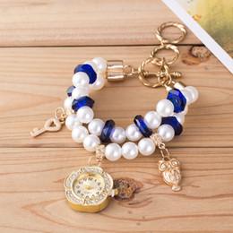 Montres de gros perle à vendre-Set tarière luxueuses et élégantes dames Ms étudiants bracelet de perles montres Femmes table set tarière de mode gros dames de haute qualité regarder