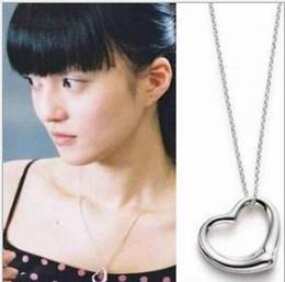 Assiettes en porcelaine pour en Ligne-Hot vendent argent plaqué nouveaux collier pendentif en forme de coeur Hollow Bijoux Chaîne chaîne de charme Livraison gratuite en Stock Chine