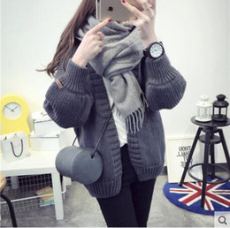 Sweater coat female autumn and winter in the long paragraph thicken loose Korean version of the wild wool clothes spring students knitted ca