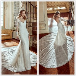 Promotion manches longues boutons robe backless de mariage 2017 New Elegant Sheer Long Sleeves Lace Mermaid Robes de mariée Backless Chapel Train Wedding Robes de mariée avec des boutons