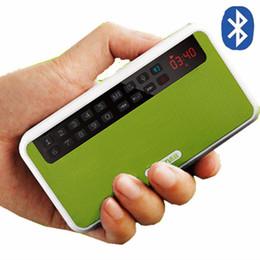 Promotion boîte de haut-parleur de radio Vente en gros Rolton E500 mini haut-parleur bluetooth support téléphonique bluetooth / carte TF / MP3 / FM radio / écouteurs / lumière LED / sons record