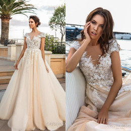 Wholesale Cap Sleeves D Flora Lace Appliques Wedding Dresses Heavily Embroidered V Neckline Romantic Princess Ivory Beach Wedding Bridal Gowns