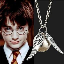 Acheter en ligne Anges ailes-Nouvelles idées Europe et le film des États-Unis Harry Potter collier anneau en or bronze antique argent ange aile charme pendentif quidditch necklac