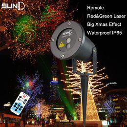 Venta al por mayor- Suny RG remoto 8 grandes motivos de Navidad proyector láser de luz al aire libre IP65 impermeable copo de nieve de Navidad Santa Claus jardín luces desde gran luz de copo de nieve fabricantes