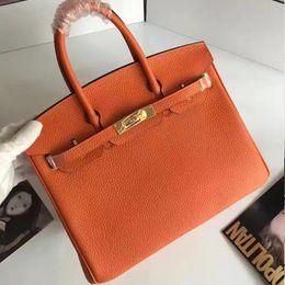 The European high-end handbags new embossed Handbag Shoulder Messenger Bag head layer cowhide leather platinum package