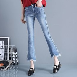 Spring edge fringed flared jeans female Korean elastic thin Weila pants nine points high waisted denim flares