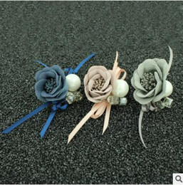 Wholesale Clothing accessories brooches bouquet Han edition cloth art The roses ribbon clips have colors please note you want colors
