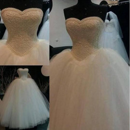 Stuning Spring Ball Gown Wedding Dresses With Pearls Sweetheart Tulle Floor Length Sequined Lace Appliques Puffy Bridal Gowns