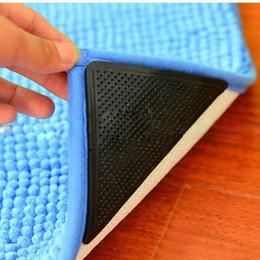 Wholesale Triangular Non slip Mats Fixed Carpet Rug Carpet Mat Grippers Non Slip Skid Silicone Bath Living Room Anti skid Pads