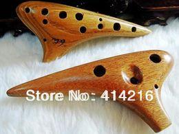 Vente en gros-la plus récente flûte 12 trous SC High c noyer raffiné instrument de musique Ocarina bois woods holes on sale à partir de trous bois fournisseurs