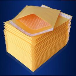 Kraft enveloppe jaune en Ligne-100pcs Plusieurs tailles Jaune Kraft Bullet Mailing Enveloppe Sacs Bulle Mailers Enveloppes Rembourrées Emballage Sacs d'expédition