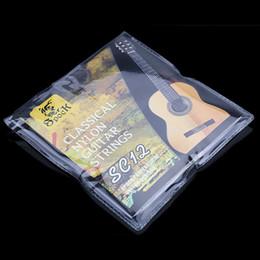 Descuento guitarra acústica de nylon SC12 Seis Nylon Cuerdas Guitarra Clásica Plata Juego de cuerdas de chapa Super Light para Guitarra Acústica Instrumento Musical
