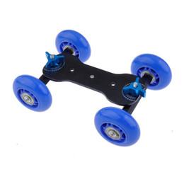 Acheter en ligne Plates-formes de caméra pour dslr-Haut-parleur de roulement mobile table de Yaomeng Rail de roulement vidéo Dolly Car Skater pour Speedlite Appareil photo caméscope DSLR (noir, bleu, rouge)