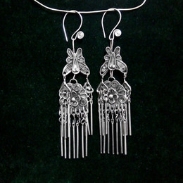 Guizhou Miao silver startling step by step with dumping the world Princess filigree manual tassel butterfly earrings wholesale folk style