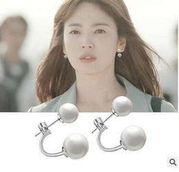 Sea of a shell wearing two Korean version of the winter wind blowing in the same paragraph pearl 925 earrings
