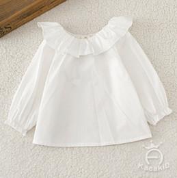 Descuento muñecas de la muchacha El bebé embroma la camisa el nuevo niño de la camisa de la manga de la solapa del falbala de las muchachas embroma la camisa blanca de la muñeca remata la ropa A0495 del algodón de los niños