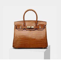 Fashionable real leather handbag tan