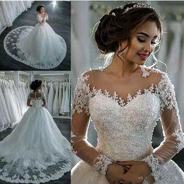 2020 Vintage Long Sleeve A Line Wedding Dresses Sheer Crew Neck Lace Appliques Beaded Vestios De Novia Bridal Gowns with Buttons