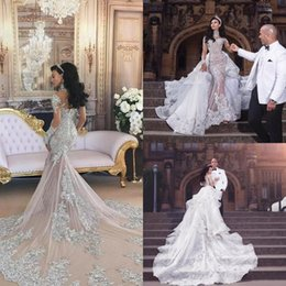 Retro Sparkly 2017 Wedding Dresses With Detachable Skirt Sheer Mermaid Beaded Lace Illusion Long Sleeves Arabic Chapel Bridal Gowns Dubai