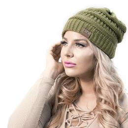 CC Caps CC hats Knitted Beanie Fashion Girls women Winter Warm Hat High Bun Beanie Hat Casual Beanies 2018 Hot Sale