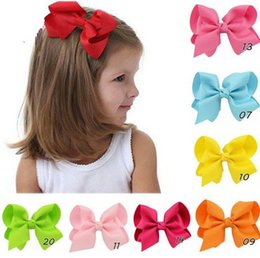 Wholesaler 4 inch Knot centre Baby Girls Solid Grosgrain Ribbon Hair bows With Alligator Clips