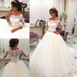 Elegant 3 4 Long Sleeves Lace Top Wedding Dresses With Crystals Sash Sheer Neck A Line African Bridal Dresses Button Back Wedding Gowns