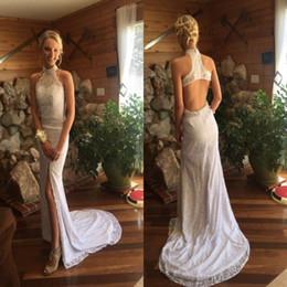 2018 New Lace Mermaid Wedding Dresses Halter Neck Sleeveless Hollow Back Bridal Gowns Summer Beach Boho Slit Wedding Gowns Cheap