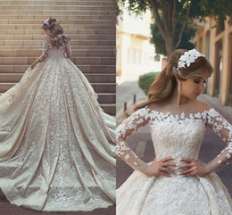 2018 Gorgeous Lace Wedding Dresses Sheer Neck Long train Long Sleeves Crystals Ruffles Appliques Arabic Dubai Wedding Gowns Custom Made