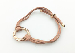 PU STRETCHED BRACELET WITH SIMPLE ROUND METAL IN BLUSH COLOR FOR FEMALE ON WHOLESALE
