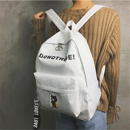 2018 new canvas shoulder bag middle school student bag Korean version of the College wind backpack fashion travel bag casual double back