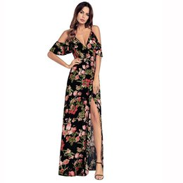 high-waisted floral dress new cross-border European and American women's wear hot style strap v-neck high-waisted floral dress.