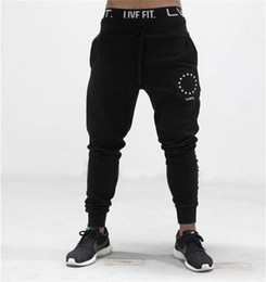 Muscle fitness brothers sports casual cotton trousers male breathable Slim beam feet guard pants