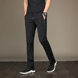 the Spring and summer new men's leisure Korean version of popular shank trousers taper mid-waist trousers