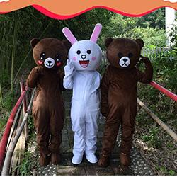 Custom web celebrity bear costume with a brown bear doll costume and a large bear doll dress with a body attached to an adult flyer mascot