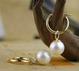 A Pair of 10-11mm South Sea White Round Pearl Earrings 14k Gold Clasp