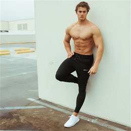 New Muscle fitness brother quick-drying spring and autumn new men's running training Slim close feet casual sports trousers