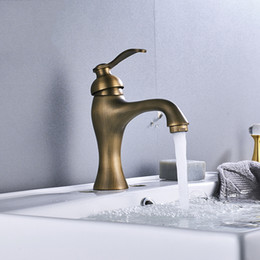 Classic Single Handle One Hole Antique Brass Wall Mounted Basin Faucet Dual Cross Handles Ceramic Base