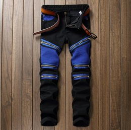 European and American fashion men's trousers, men's motorcycle zippers, small straight tube jeans, stars. Rock and roll style.