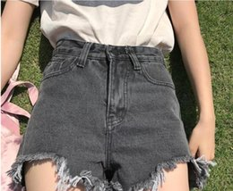 In real time, the new summer wear, fashionable, high waist, thin and thin, virtual edge, wild show, thin jeans shorts.