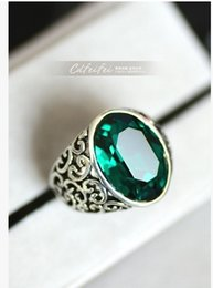 Antique imitation silver alloy electroplating hollowed-out elliptical dove merlin green crystal forefinger exaggerated decoration ring ring.
