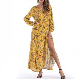 2018 Europe and the United States spring and summer fashion V-neck long-sleeved strap printed bohemian dress
