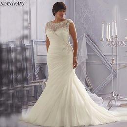 2018 Discount Wedding Dresses Scoop Cap Sleeves Opulent Ivory White Crystal Beading Appliques Organza Mermaid Plus Size