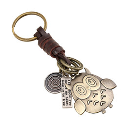 China wholesale Retro braiding bag pendants Alloy Owl key chains Genuine leather bag pendant Punk cowhide keychain
