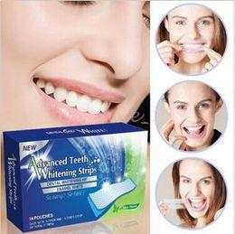 100lot CCA3473 caliente 28pcs PRO 360 grados adelantaron los dientes dentales que blanquean el blanco del esmalte del kit que tiras los dientes dentales del RRP que blanquean la tira Whitestrip