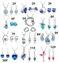 12 Juego de alta calidad de cristal de diamante colgante de collar y pendientes Establece una variedad de estilos para el conjunto de joyas de las mujeres