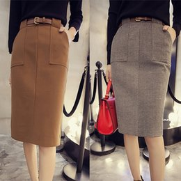 Wholesale 2015 autumn and winter woolen skirts package hip pocket was thin woolen bust skirt with belt