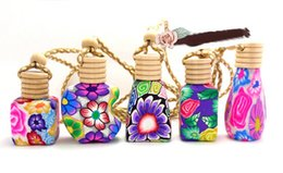 Wholesale ml Car hang decoration Ceramic essence oil Perfume bottle Hang rope bottle with different kinds of perfume