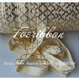 Wholesale 5 quot fold over elastic for children s accessories gold foil big quatrefoil printed foe ribbon cream yards roll